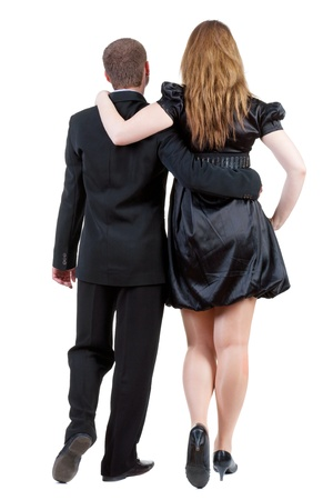 Back view of going young business couple (man and woman) .  photo