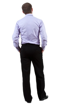 backside: back view of Business man  looks on wall.  Young guy in shirt watching.   Stock Photo