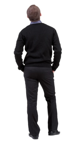 businessman standing: back view of Business man  looks ahead. Young guy in sweater watching.