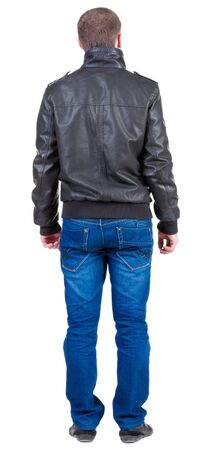 Back view of handsome man in jacket  looking    Standing young guy in jeans and  jacket. Rear view people collection.  backside view of person.  Isolated over white background. Stock Photo - 13769835