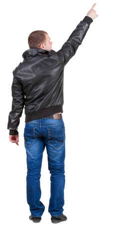 Back view of pointing  man in jeans and jacket. Rear view people collection.  backside view of person.  Isolated over white background.  gesticulating young guy. photo