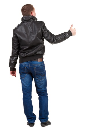Back view of  man shows thumbs up.   Rear view people collection.   photo