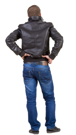 Back view of handsome man in jacket.  Standing young guy in jeans and  jacket. Rear view people collection.  backside view of person.  Isolated over white background. Stock Photo - 13769847