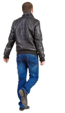 Back view of walking handsome man in jacket.   going young guy in jeans and  jacket. Rear view people collection.  backside view of person.  Isolated over white background. photo
