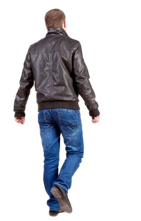 Back view of going handsome man in jacket. walking young guy in jeans and jacket. Rear view people collection. backside view of person. Isolated over white background.
