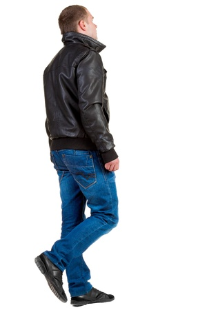 Back view of going  handsome man in jeans and jacket.  walking young guy in jeans and  jacket. Stock Photo - 13683116