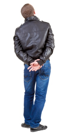 Back view of handsome man in jacket  looking up.   Standing young guy in jeans and  jacket. Stock Photo - 13705502