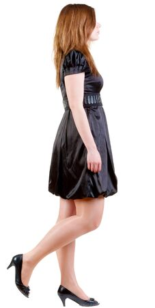 back view of walking  brunette woman  in black dress. beautiful girl in motion.  backside view of person.  Rear view people collection. Isolated over white background. photo