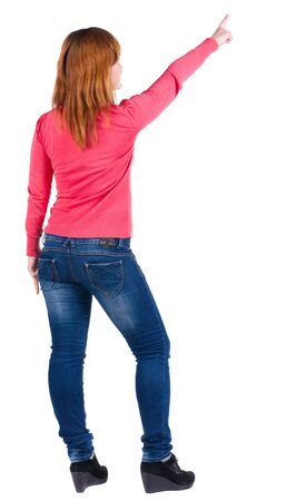 Back view of  pointing woman. beautiful blonde  girl in jeans.  Rear view people collection.  backside view of person.  Isolated over white background. photo