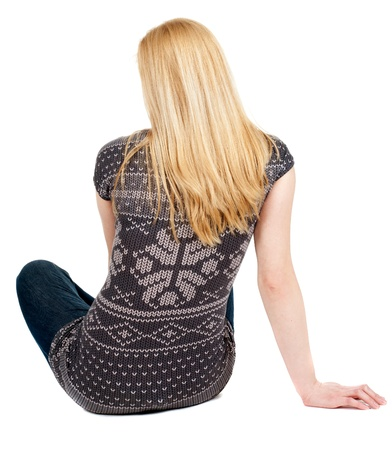 Back view of beautiful young woman sitting on the floor and looks into the distance. Blonde girl relaxes. Rear view people collection.  backside view of person.  Isolated over white background. photo