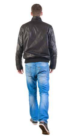 person walking: Back view of walking handsome man in jacket.   going young guy in jeans and  jacket. Rear view people collection.  backside view of person.  Isolated over white background.