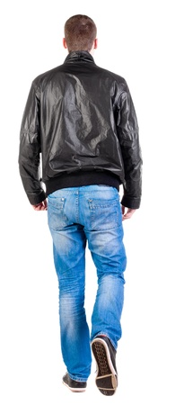 striding: Back view of walking handsome man in jacket.   going young guy in jeans and  jacket. Rear view people collection.  backside view of person.  Isolated over white background.
