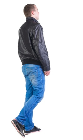 Back view of walking handsome man in jacket.   going young guy in jeans and  jacket. Rear view people collection.  backside view of person.  Isolated over white background. Stock Photo - 13772960
