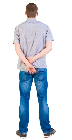 hands behind head: Back view of young men in  shirt and jeans.  Guy  looks away. Rear view people collection.  backside view of person.  Isolated over white background. Stock Photo