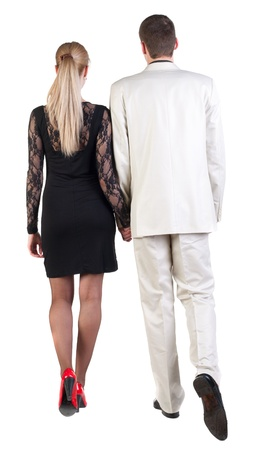 Back view of going young business couple (man and woman) . walking beautiful friendly girl in dress and guy in suit. Rear view people collection.  backside view of person.  Isolated over white background. photo
