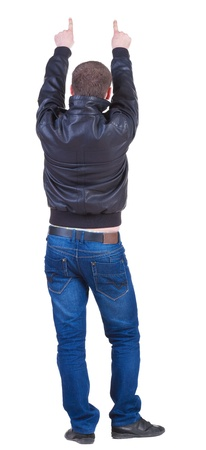 gesticulating: Back view of pointing  man in jeans and jacket. Rear view people collection.  backside view of person.  Isolated over white background.  gesticulating young guy. Stock Photo