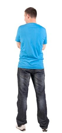 Vue arrière de jeunes hommes en bleu t-shirt et jeans. Guy détourne le regard. Vue arrière des gens de collecte. vue arrière de la personne. Isolé sur fond blanc. Banque d'images