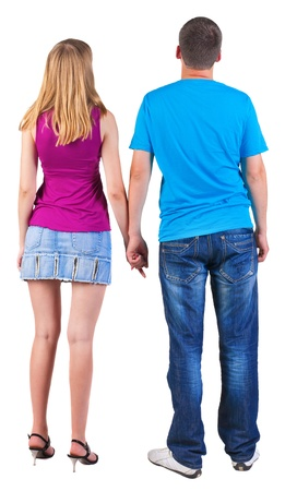 personnes de dos: Vue arri�re de jeune couple enlac� (homme et femme) �treinte et se pencher sur la distance. belle jeune fille sympathique et Guy ensemble. Vue arri�re des gens de collecte. vue arri�re de la personne. Isol� sur fond blanc.