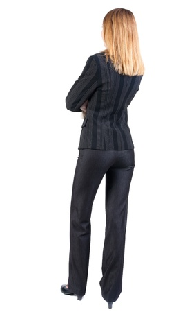 back view of standing beautiful blonde  business woman. Young girl in suit.  Rear view people collection.  backside view of person.  Isolated over white background. photo