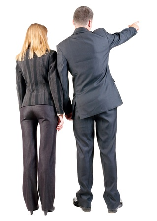 Back view of  pointing business team. young couple (man and woman) .  beautiful friendly girl and guy in suit together. Rear view people collection.  backside view of person.  Isolated over white background.