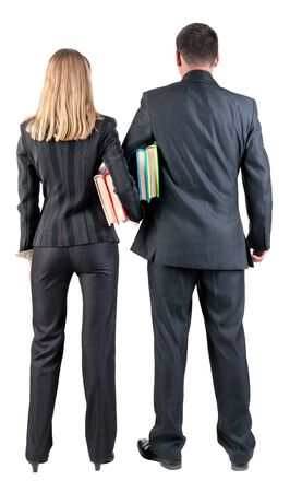 Back view of  business team look into the distance. young couple (man and woman) with books.  beautiful friendly girl and guy in suit together. Rear view people collection.  backside view of person.  Isolated over white background. photo