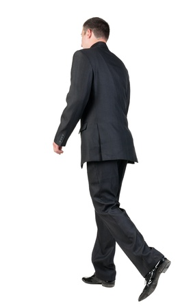 back view of walking  business man.  going young guy in black suit. Isolated over white background. Rear view people collection.  backside view of person.   Stock Photo - 13828383