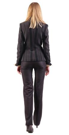 2ddada6d4 Foto de archivo - Vista posterior del pie mujer de negocios. va niña en traje  negro. Vista posterior recogida de las personas. trasero vista de la  persona.