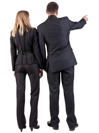 Back view of  pointing business team. young couple (man and woman)