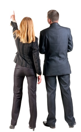 man back view: Back view of  pointing business team. young couple (man and woman)