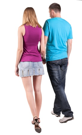 looking to side: Back view of walking young couple (man and woman). going beautiful friendly girl and guy  together. Rear view people collection. backside view of person. Isolated over white background