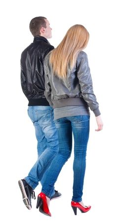 Back view of walking young couple (man and woman). going beautiful friendly girl and guy  together. Rear view people collection. backside view of person. Isolated over white background