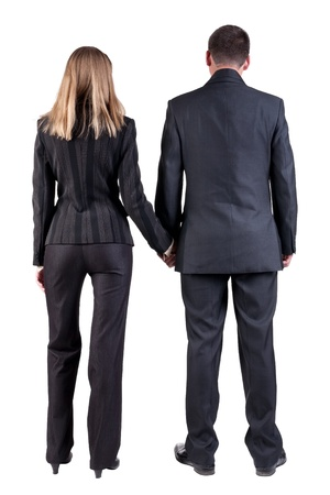 Back view of  business team look into the distance. young couple (man and woman). beautiful friendly girl and guy in suit together. Rear view people collection. backside view of person. Isolated over white background photo