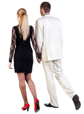 Back view of walking  young business team  (man and woman) . going  beautiful friendly girl in dress and guy in suit. Rear view people collection.  backside view of person.  Isolated over white background. photo