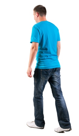 Back view of walking handsome man in t-shirt.   going young guy in jeans  Rear view people collection.  backside view of person.  Isolated over white background. photo