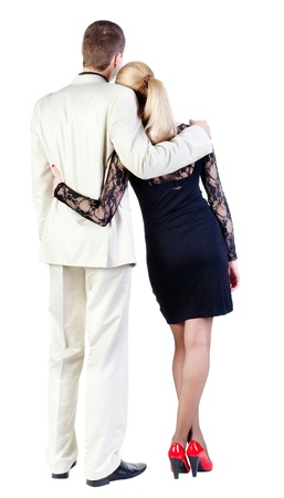 Back view of  business team look into the distance. young couple (man and woman) rear view.  beautiful friendly girl in dress and guy in suit together. Rear view people collection.  backside view of person.  Isolated over white background.