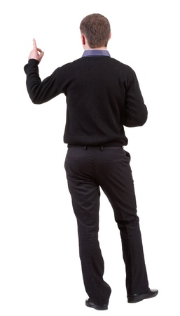 gesticulating: Back view of pointing business man. gesticulating young guy in black suit. Rear view people collection.  backside view of person.  Isolated over white background.