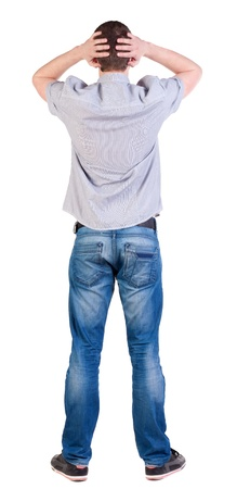 Back view of shocked  man in shirt . Upset adult men. Rear view people collection.  backside view of person.  Isolated over white background. photo