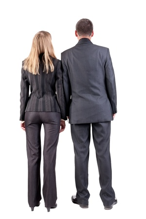 Back view of business team look into the distance. young couple (man and woman) . beautiful friendly girl and guy in suit together. Rear view people collection. backside view of person. Isolated over white background. photo
