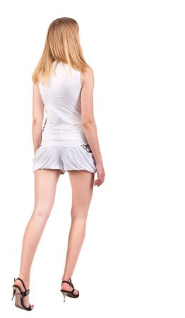 back view of going  woman  in shorts. beautiful blonde girl in motion.  backside view of person.  Rear view people collection. Isolated over white background. photo