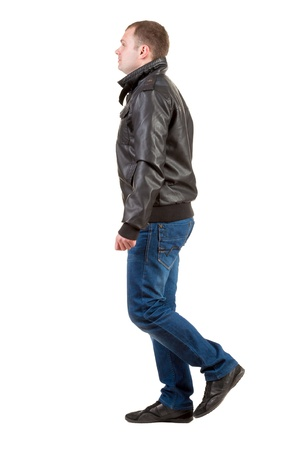 Back view of going  man in jacket.  walking young guy in jeans and  jacket. Rear view people collection.  backside view of person.  Isolated over white background. photo