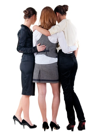 three  young bussineswoman pointing. back view of business team work. .Rear view people collection. backside view of person. Isolated over white background. Stock Photo - 15072233