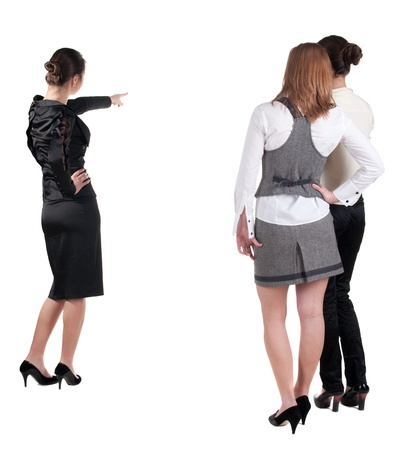 rear views: back view of three young business woman pointing. Team work. Rear view people collection.  backside view of person.  Isolated over white background.