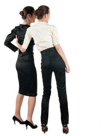 Two  young business woman looking at wall.  Rear view people collection.  backside view of person.  Isolated over white background.