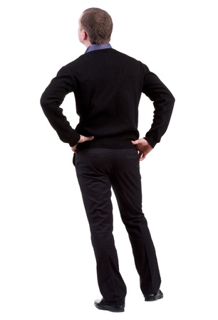 back view of Business man  looks ahead. Young guy in sweater watching.  Rear view people collection.  backside view of person.  Isolated over white background. photo