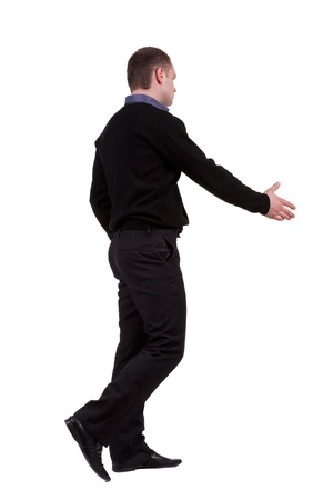 businessman in the movement reaches out to shake hands. Rear view people collection. backside view of person. Isolated over white background. photo