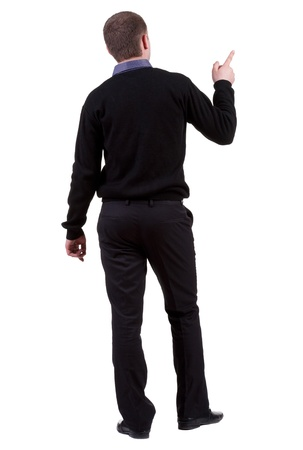Back view of pointing business man. gesticulating young guy in black suit. Rear view people collection.  backside view of person.  Isolated over white background. photo