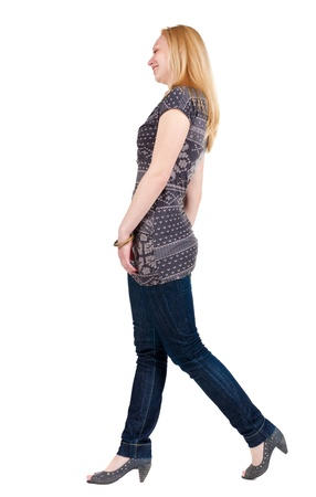 back view of walking woman . going blonde girl in motion. Rear view people collection.  backside view of person. Isolated over white background. Stock Photo - 15072199