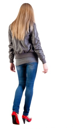 walking blonde girl in motion. during a walk.  going woman back view . Rear view people collection.  backside view of person.  Isolated over white background. Imagens