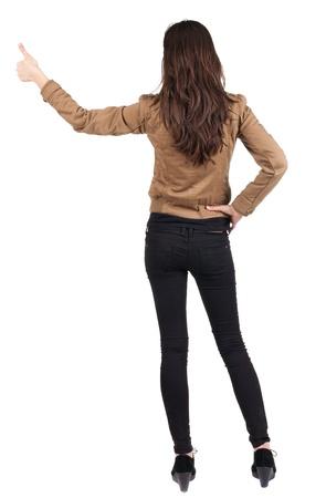 Vista posteriore di di bella donna bruna in giacca marrone rende pollice Risultati di emozioni positive con OK concetto di segno posteriore Vista posteriore raccolta la gente di persona Isolato su sfondo bianco