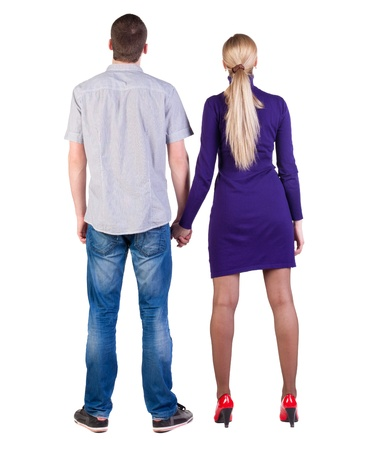 Back view of young embracing couple  man and woman  hug  look up  beautiful friendly girl and guy together  Rear view people collection   backside view of person   Isolated over white background  photo